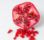A half pomegranate with seeds (isolated) Royalty Free Stock Image