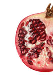 Half pomegrante isolated. Half pomegranate isolated on a white background, ruby red in color Stock Photos