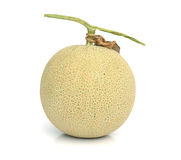 Half and portion cut ripe cantaloupe on white  Stock Image
