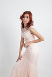 Half portrait of a beautiful girl in a light pink dress isolated Royalty Free Stock Photo