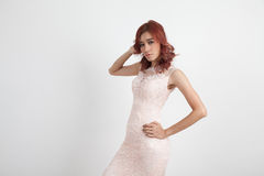 Half portrait of a beautiful girl in a light pink dress isolated Stock Image