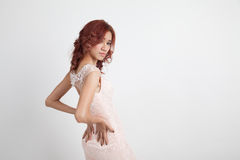 Half portrait of a beautiful girl in a light pink dress  Stock Photography
