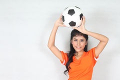 Half Portrait Beautiful woman hold ball over her head with weari. Image of Half Portrait Beautiful woman hold ball over her head with wearing football top Stock Photography