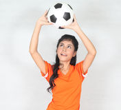 Half Portrait Beautiful woman hold ball over her head with weari. Image of Half Portrait Beautiful woman hold ball over her head with wearing football top Royalty Free Stock Images