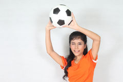 Half Portrait Beautiful woman hold ball over her head with weari. Image of Half Portrait Beautiful woman hold ball over her head with wearing football top Royalty Free Stock Photography