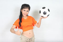 Half Portrait Beautiful woman hold ball over her head with weari. Image of Half Portrait Beautiful woman hold ball over her head with wearing football top Stock Photos
