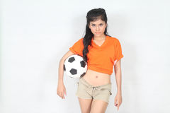 Half Portrait Beautiful woman hold ball over her head with weari. Image of Half Portrait Beautiful woman hold ball over her head with wearing football top Stock Images