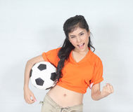 Half Portrait Beautiful woman hold ball over her head with weari. Image of Half Portrait Beautiful woman hold ball over her head with wearing football top Stock Photo