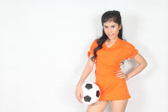 Half Portrait Beautiful woman hold ball with wearing football to Stock Photo