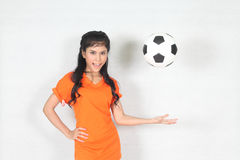 Half Portrait Beautiful woman throw up ball  with wearing footba Stock Photos