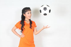 Half Portrait Beautiful woman throw up ball  with wearing footba Stock Image