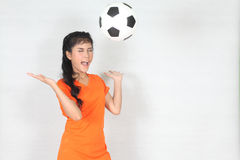 Half Portrait Beautiful woman throw up ball  with wearing footba Royalty Free Stock Photos