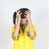 Half Portrait Beautiful woman with wearing Brazil football top h Stock Photo