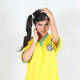 Half Portrait Beautiful woman with wearing Brazil football top. Image Half Portrait Beautiful woman with wearing Brazil football top Royalty Free Stock Photography