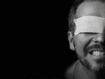 Half portrait of a blindfolded man Stock Photos