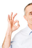 Half portrait of mature man showing perfect sign Stock Photography