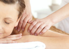 Half portrait of a woman having a massage Royalty Free Stock Photography