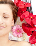 Half portrait of a woman lying with flower Stock Image