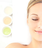 Half portrait of a woman lying on a massage table Royalty Free Stock Image