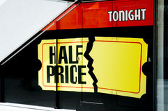 Half Price. Tickets sign in window Royalty Free Stock Image