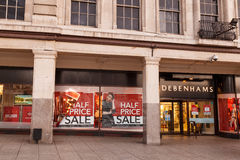 Half price sale posters in Debenhams window on Boxing Day in Not Royalty Free Stock Photo