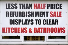 Half Price Sale Shop Window Sign Kitchens Bathrooms Refurbishment Display To Clear Signage. Window Banner Sign Sale Half Price Kitchen Bathrooms Stock Image