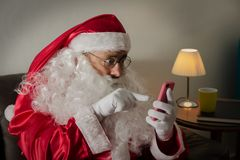 Half profile of Santa Claus relaxing in couch in the living room royalty free stock photography