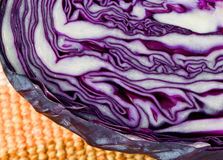 Half purple cabbage on yellow placemat Stock Photos