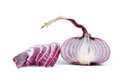 Half of purple onions and some slices. Isolated on the white background Royalty Free Stock Photo