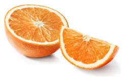 Half and a quarter of orange on an isolated white background. Close-up. royalty free stock photos