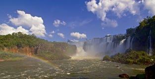 Half-rainbow looking up at Iguazu falls in Argentina Stock Photos