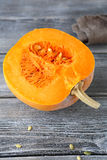 Half of raw pumpkin on the boards Stock Image