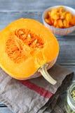 Half of raw pumpkin on napkin Royalty Free Stock Images