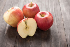 Half of red apple on wooden background Royalty Free Stock Photo