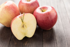 Half of red apple on wooden background Royalty Free Stock Image