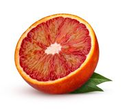 Half red blood orange with leaves isolated on white background. Royalty Free Stock Photos