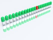Half red capsule in row of half green pills. 3D Royalty Free Stock Photography