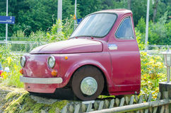 Half red Fiat 500. Essen, Nrw, Germany - June 13, 2014: Velber Langenberg district is that half red Fiat 500 car behind the front seats separated Stock Photography