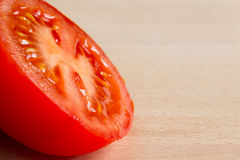 Half of a red ripe tomato Royalty Free Stock Photo