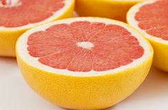Half a red tasty red grapefruit Royalty Free Stock Photo