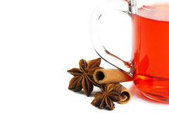 Half red tea with cinnamon sticks and star anise Royalty Free Stock Images