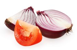 Half of red tomato, slice and half of unpeeled onion. Half of fresh red tomato near slice and half of unpeeled red onion isolated on white background Royalty Free Stock Image