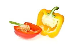 Half of red and yellow sweet peppers. Isolated on the white background Stock Image
