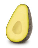 Half of ripe avocado isolated on a white Stock Images