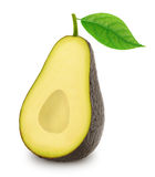 Half of ripe avocado with leaf isolated on a white Stock Photos