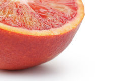 Half of ripe blood red orange white background Royalty Free Stock Photography