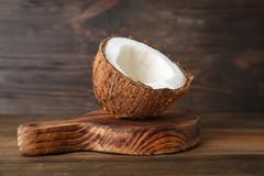 Half of ripe coconut. On wooden board Royalty Free Stock Photo