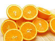 Half ripe oranges. Closeup on white background Royalty Free Stock Photography