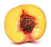 Half of ripe peach isolated. On a white Stock Photography