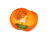 Half  of ripe persimmon Stock Photos